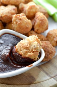 Fried Cauliflower Wings dipped in barbeque sauce