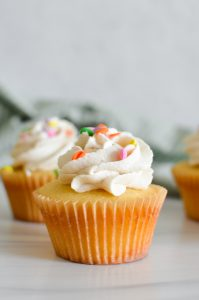 Frosted Yellow Cupcake with sprinkles