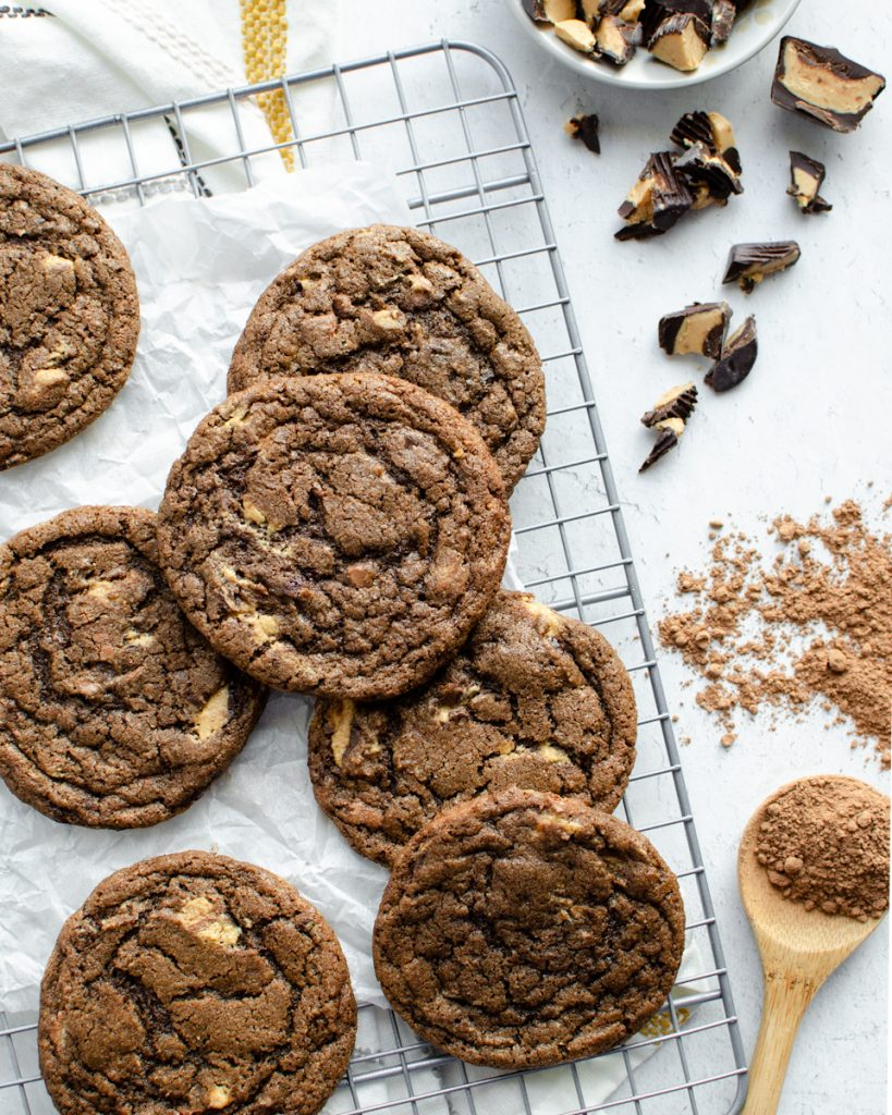 Chocolate Cookies with Peanut Butter cups on a cooling rack