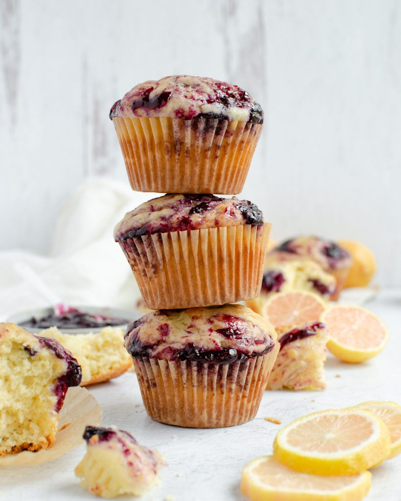 Stack of Lemon Muffins with lemons nearby