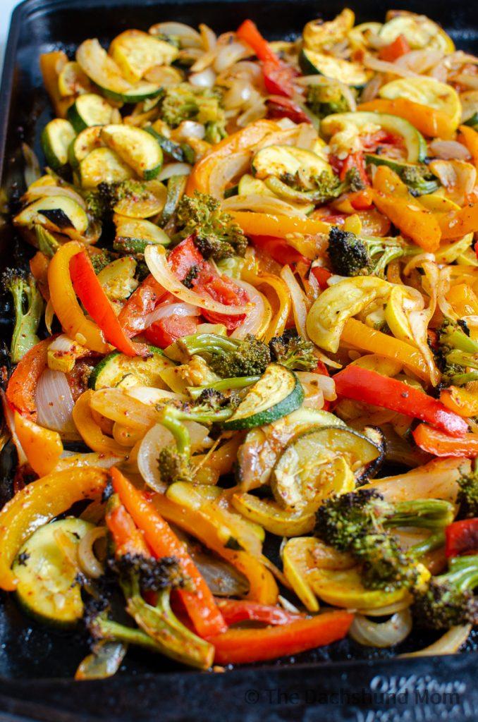 Cooked fajita veggies on a sheet pan