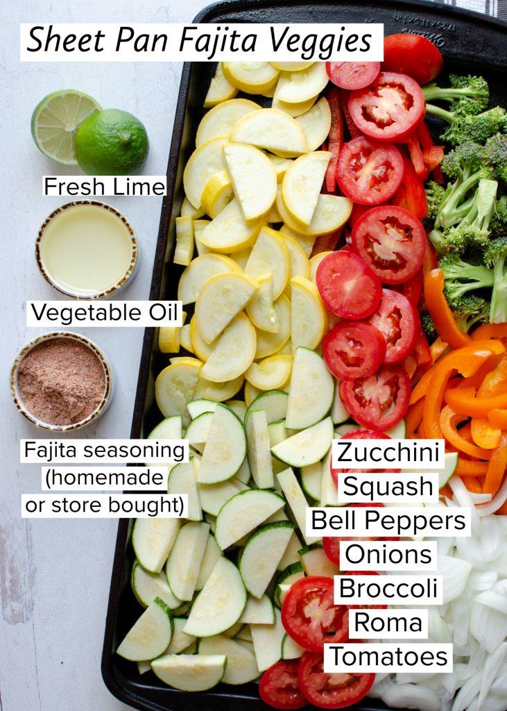 raw ingredients for fajita veggies on a sheet pan