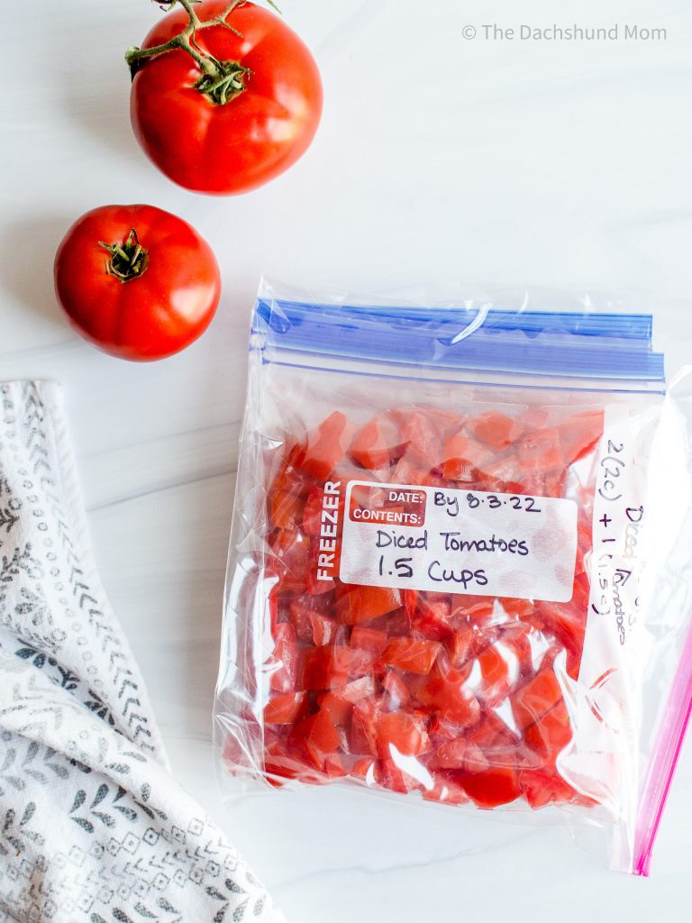 Diced fresh tomatoes in a ziptop bag for freezing
