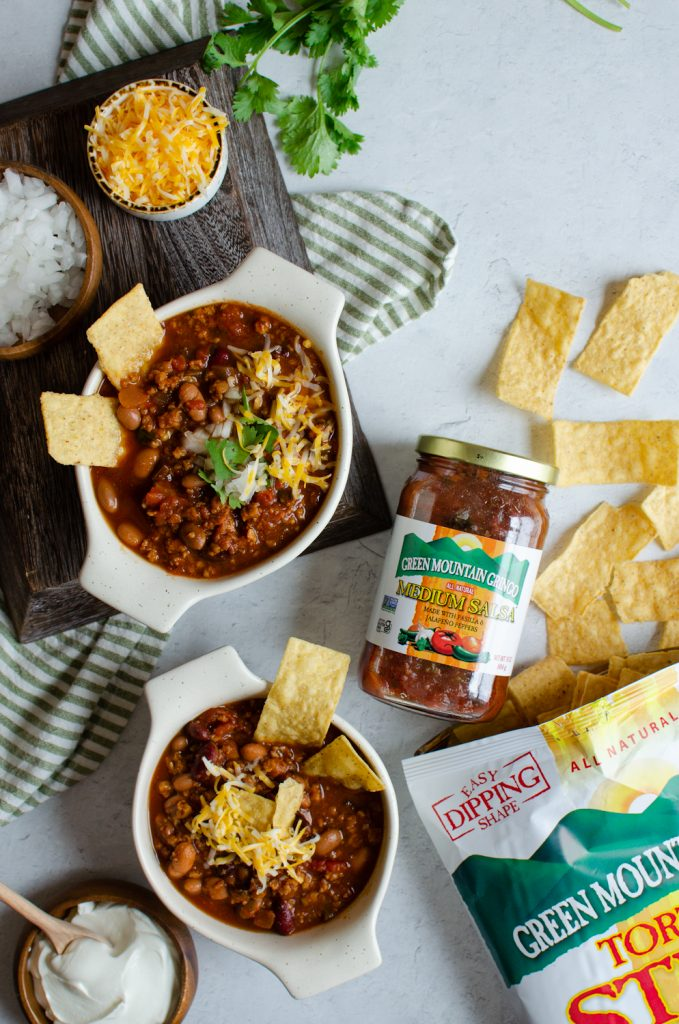 Game Day chili in bowls topped with tortilla chips