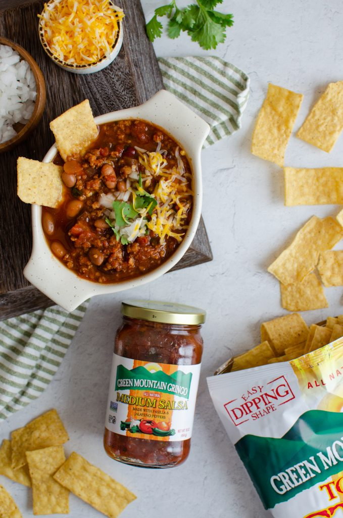 Game Day Chili on a table with tortilla chips