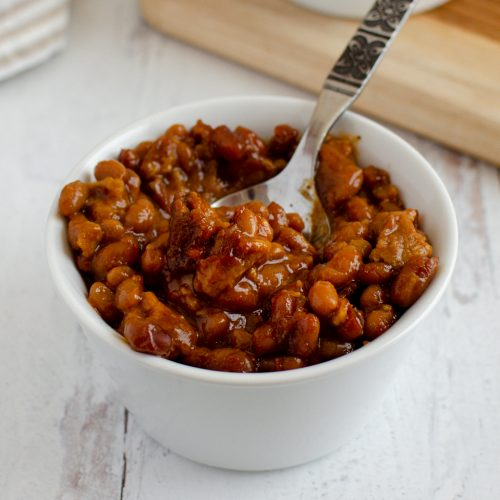 Oven baked beans with vegetarian sausage
