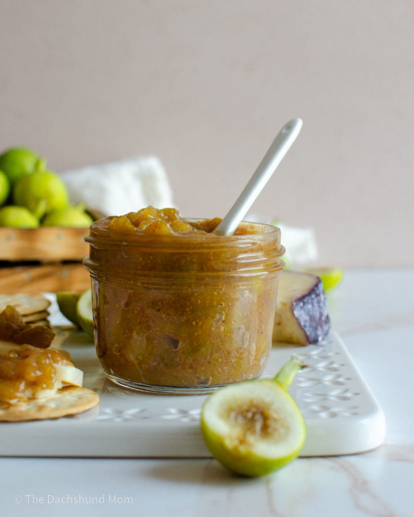 Fresh green fig jam next to a basket of figs