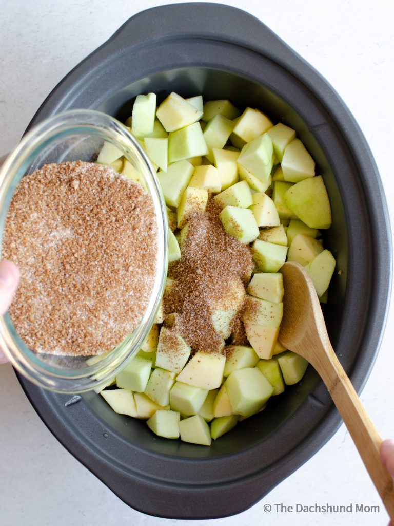 stirring sugars with apples for apple butter